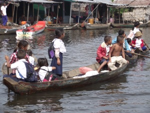 Children coming home from a school on the water