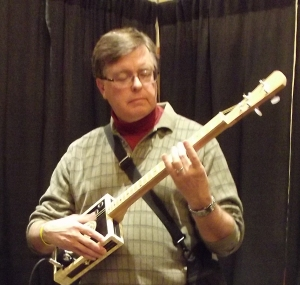 Tom playing the cigar box guitar.